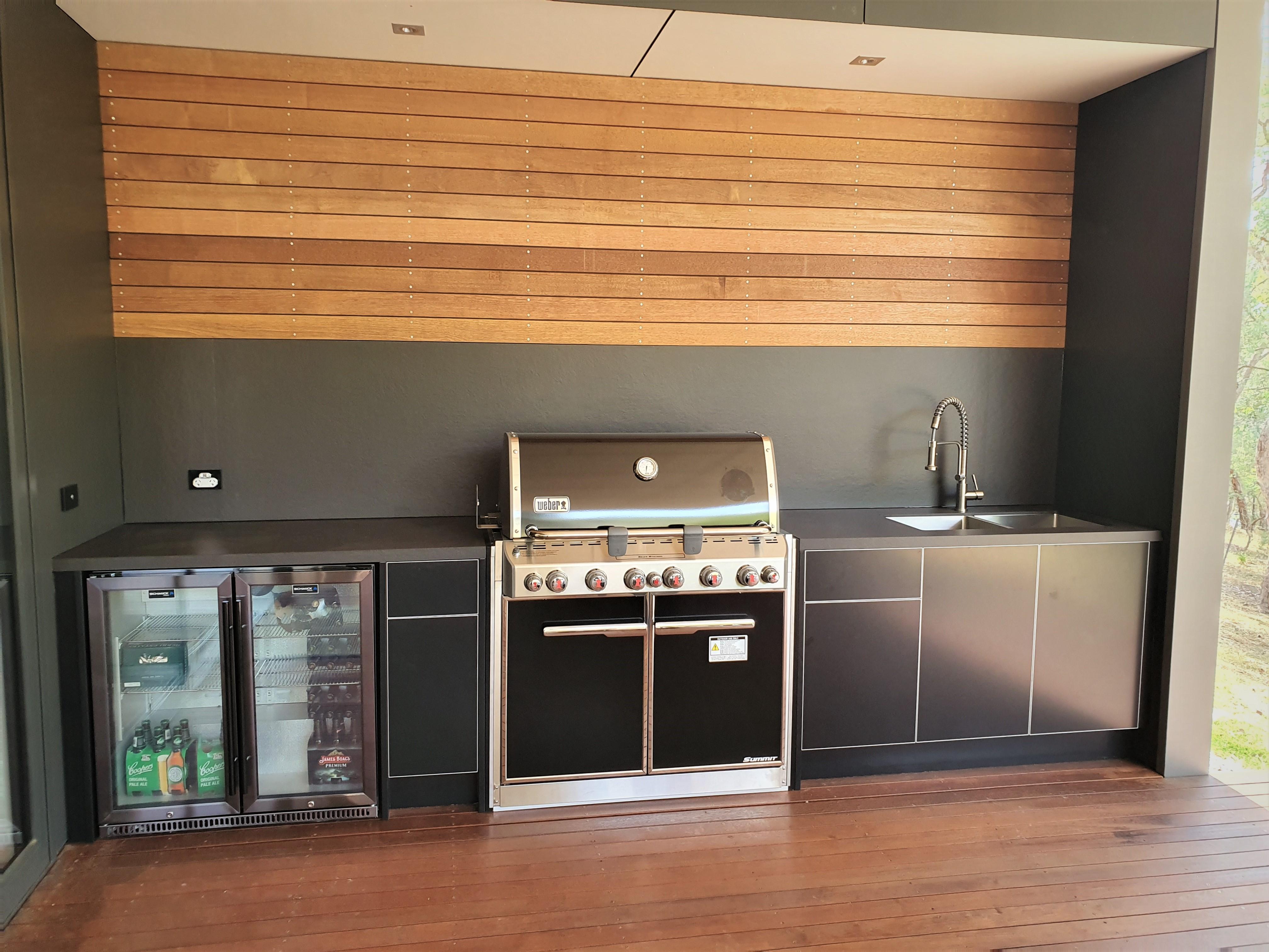 Weber Summit E660 Matte Black with Dekton Sirius benchtops and Splashbacks Timber Feature Alfresco Kitchen