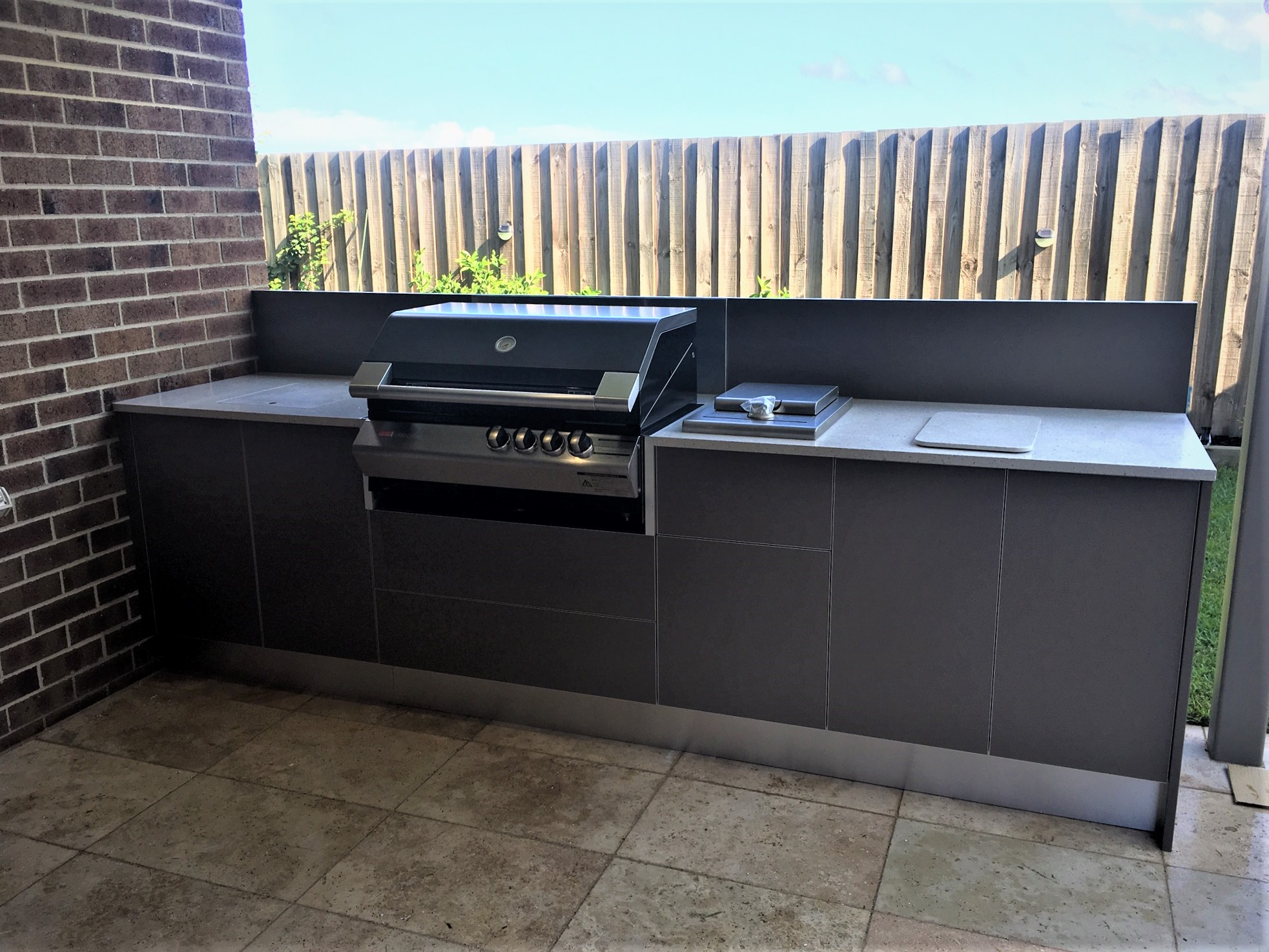 Zeigler Brown Turbo Classic Matte Mocha Cabinets with Corian Oyster Outdoor Kitchen 1